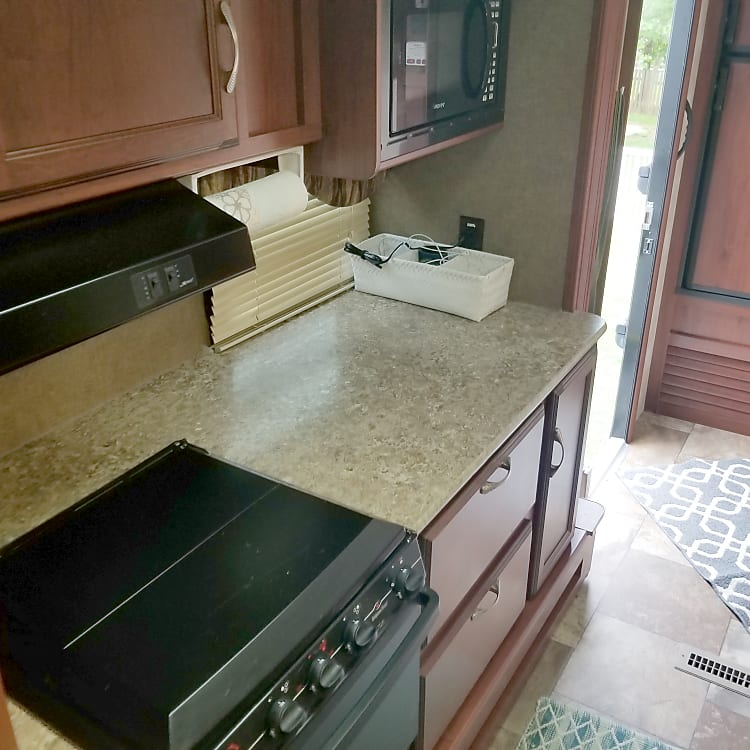 Stove, counter top and storage areas.