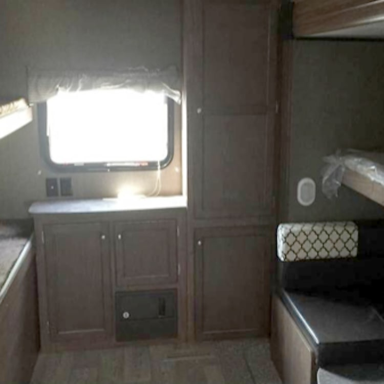 Bunk house. Top right bed folds up so the bottom can be a bed or a table.