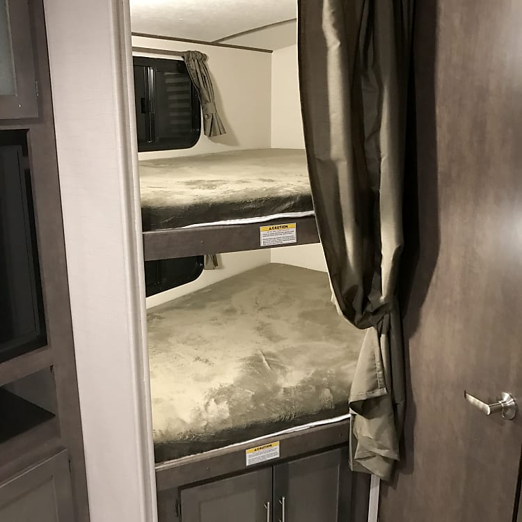 Dual bunks, each with dedicated 120v outlets, lights and windows.