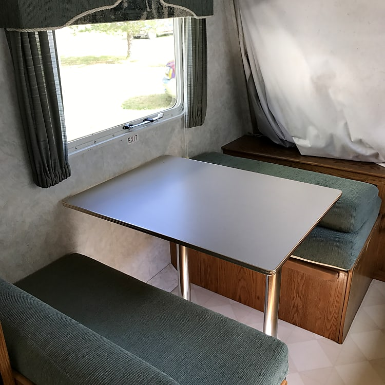 Dining table folds into a bed.  Note:  end bed is folded up in this pic