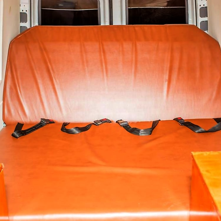 Chaise Lounge Seat with 4 seat belts in the rear.