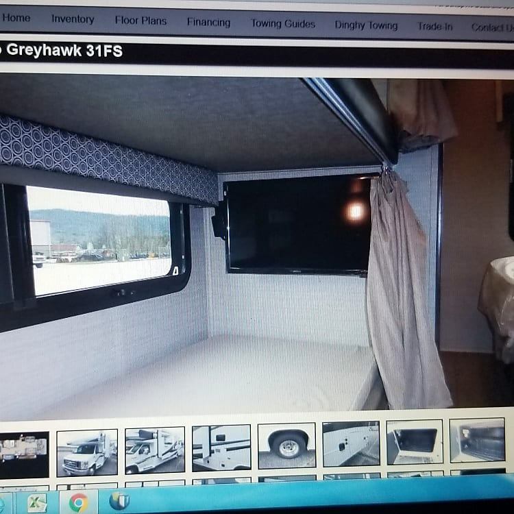 Total of 4 TV's - 2 in each Bunk, One in Master, and one located sleeping area above driver. It has an swinging arm that allows you to watch in main seating area.