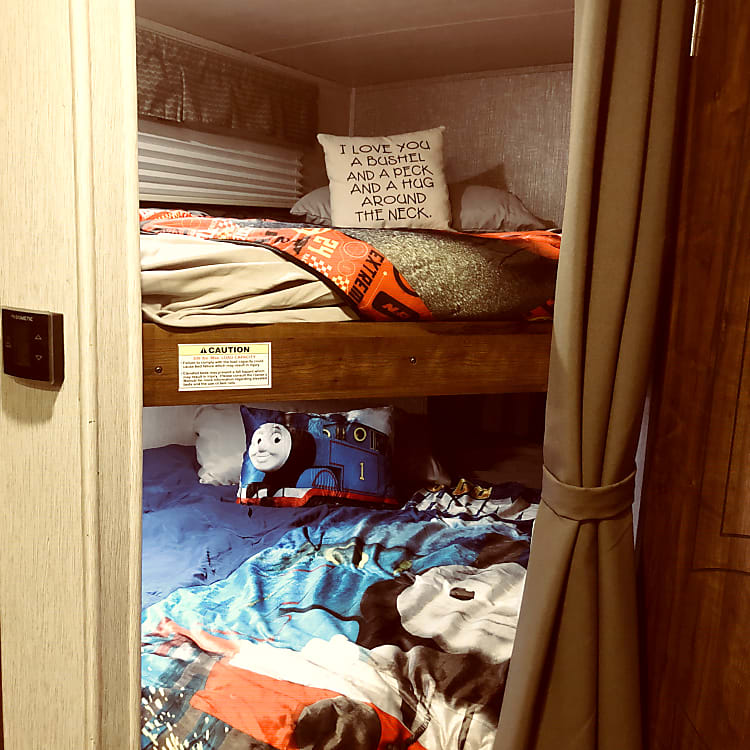 Rear bunk offers room for the kids. Rental includes sheets, blankets and pillows.