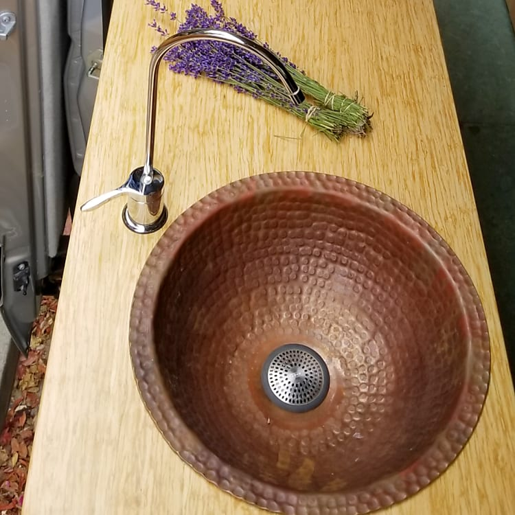 Beautiful handmade copper sink with faucet powered by an electric water pump
