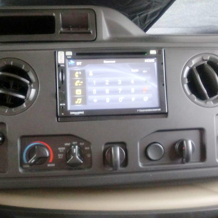 Radio with AM/FM CD player. surround sound system Navigation system