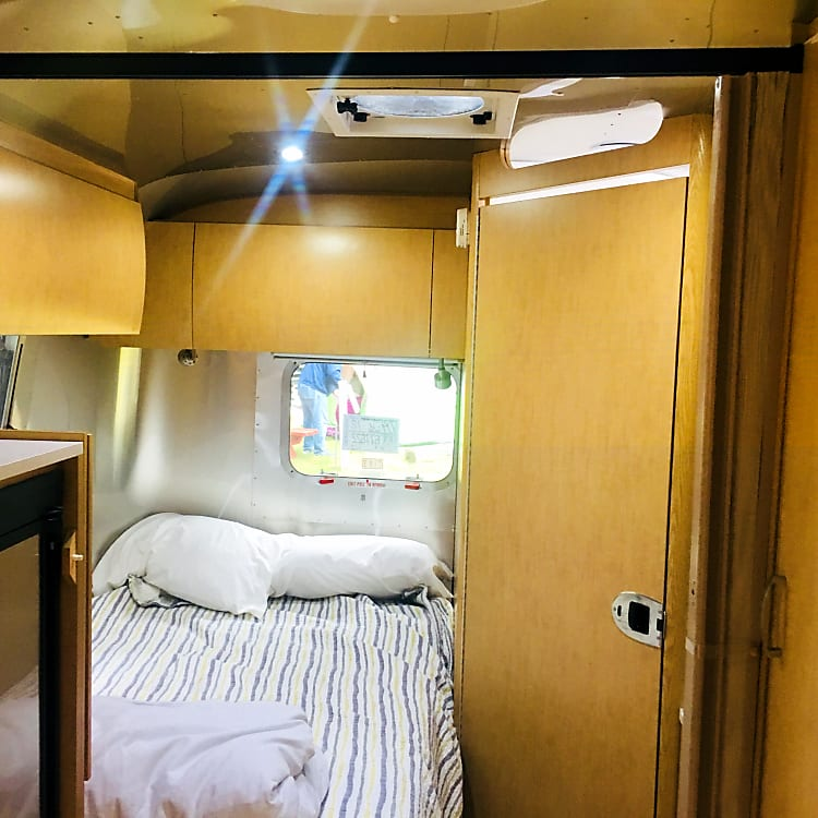 Cozy bed for two in the back of the trailer.  Room can be closed off with curtain.