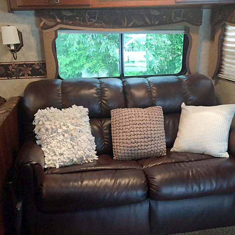 Leather couch converts to twin bed