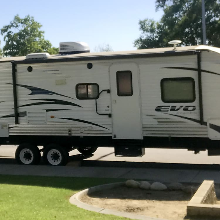 Clean exterior with large slide out, extra door from the bathroom for tent campers camping with you.