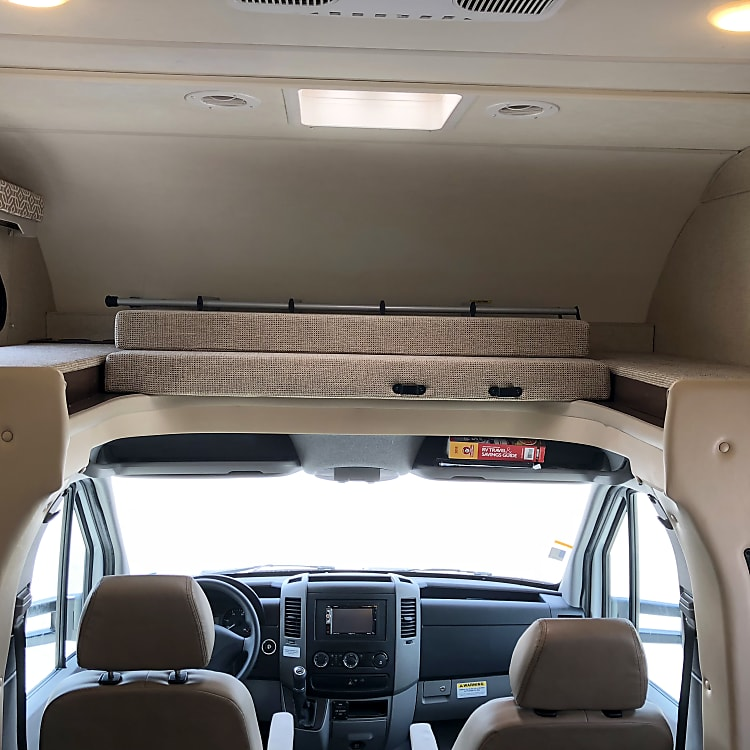 Bed above cab stored away