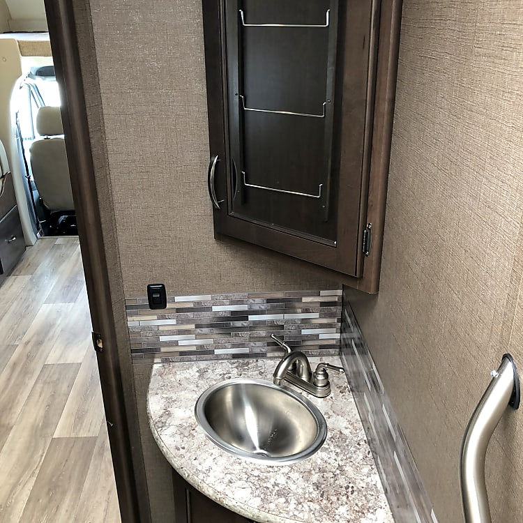 Sink and vanity in bathroom