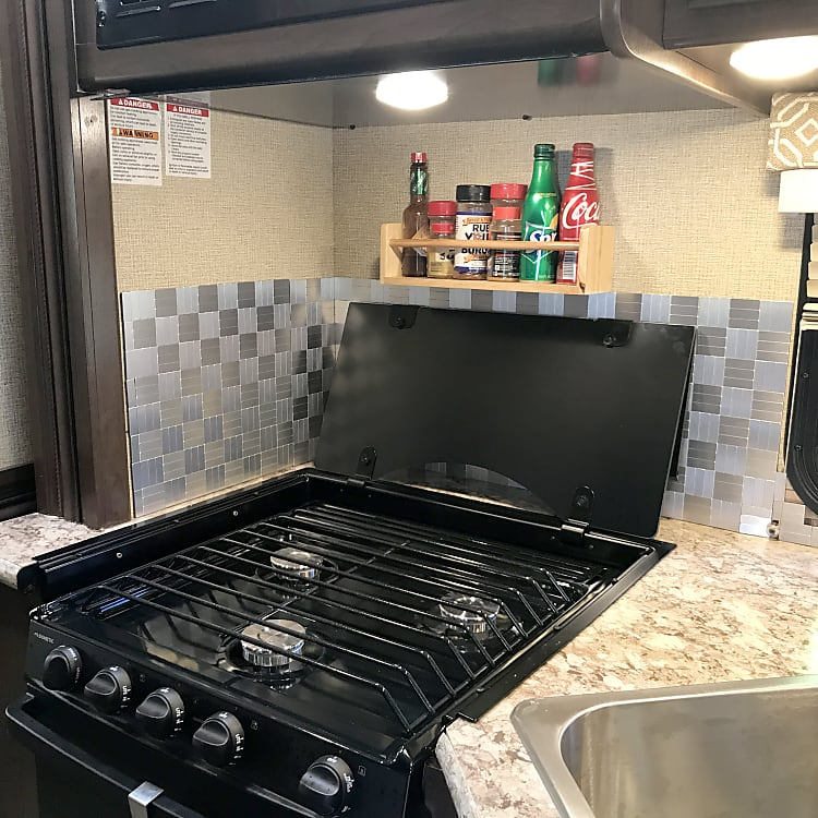 Love this stove and oven - with a backsplash that isn't stickers so it won't melt with surrounding heat! It's all easy to clean too