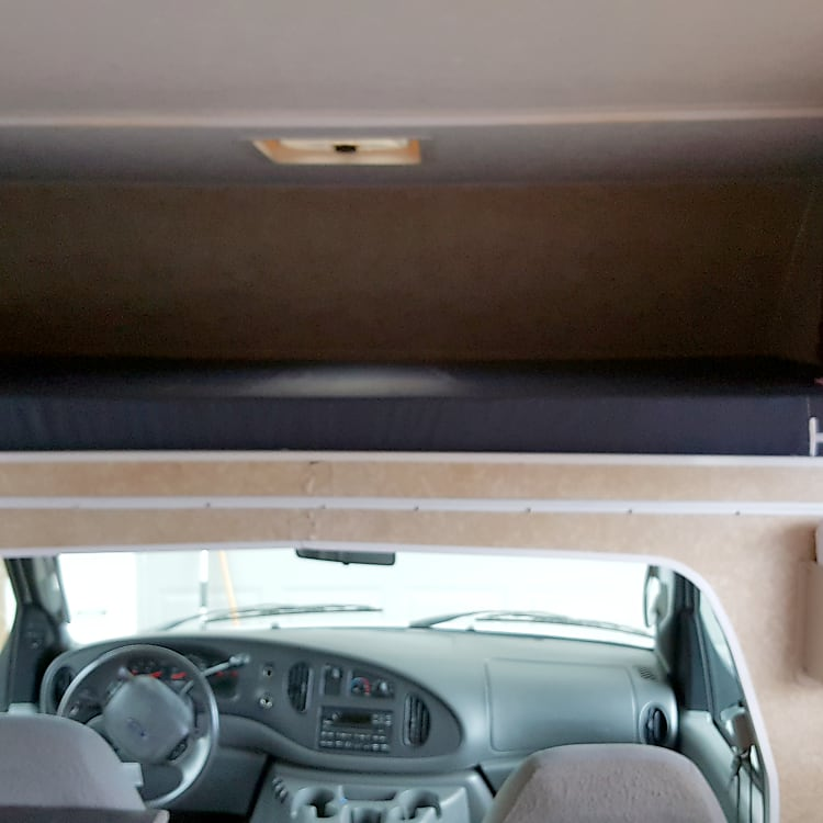 Bed above driver