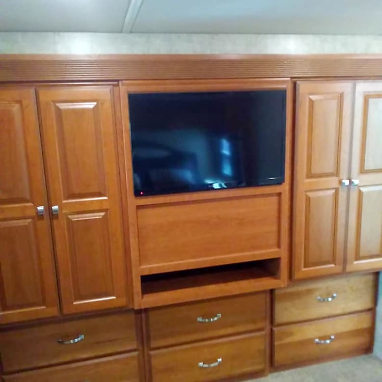 tv and wardrobe and storage in Master Bed