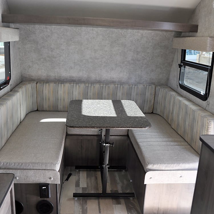 Spacious dinette converts to sleeping.