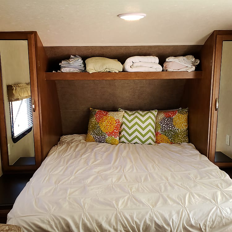 Queen size bed- murphy bed style.