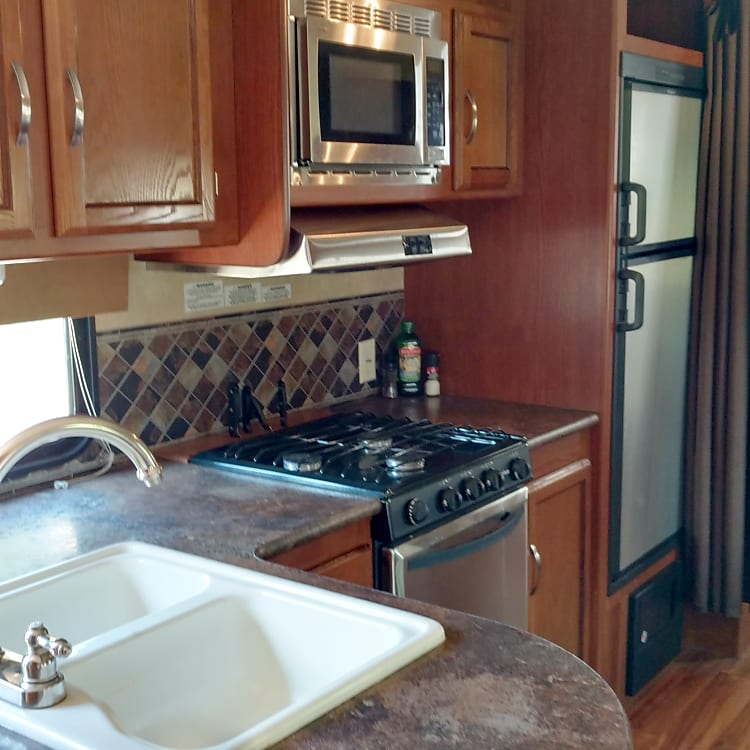 Spacious kitchen with real wood cabinets