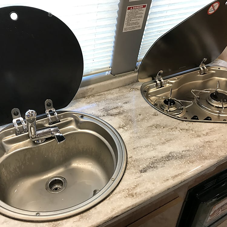 2 burner stove top with a sink