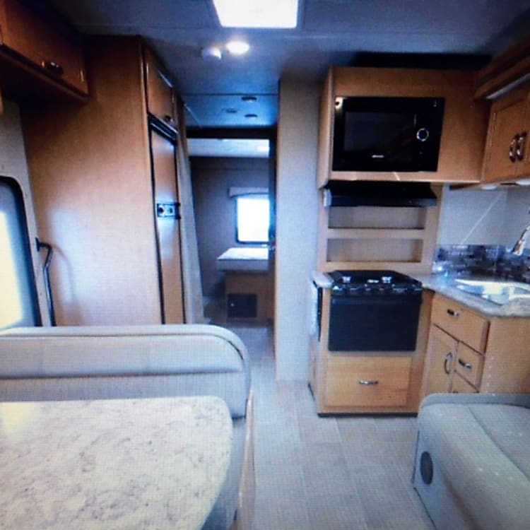 Inside RV looking toward the back. Look at all of that space!