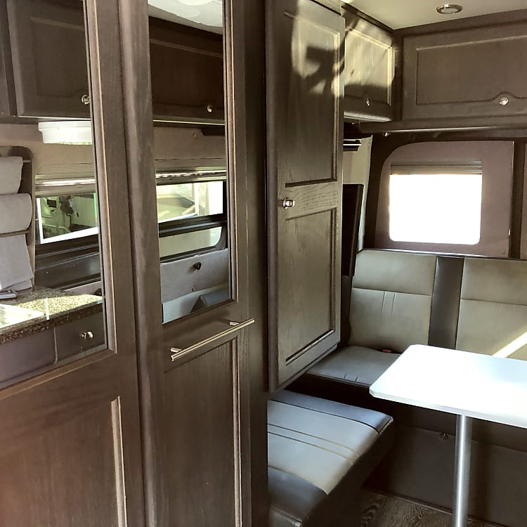 Passenger side inside facing rearward. Shower/bathroom doors are mirrored.