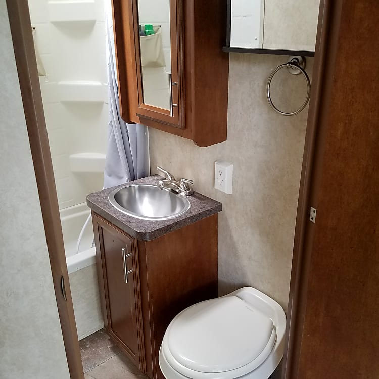 good sized restroom with a full shower