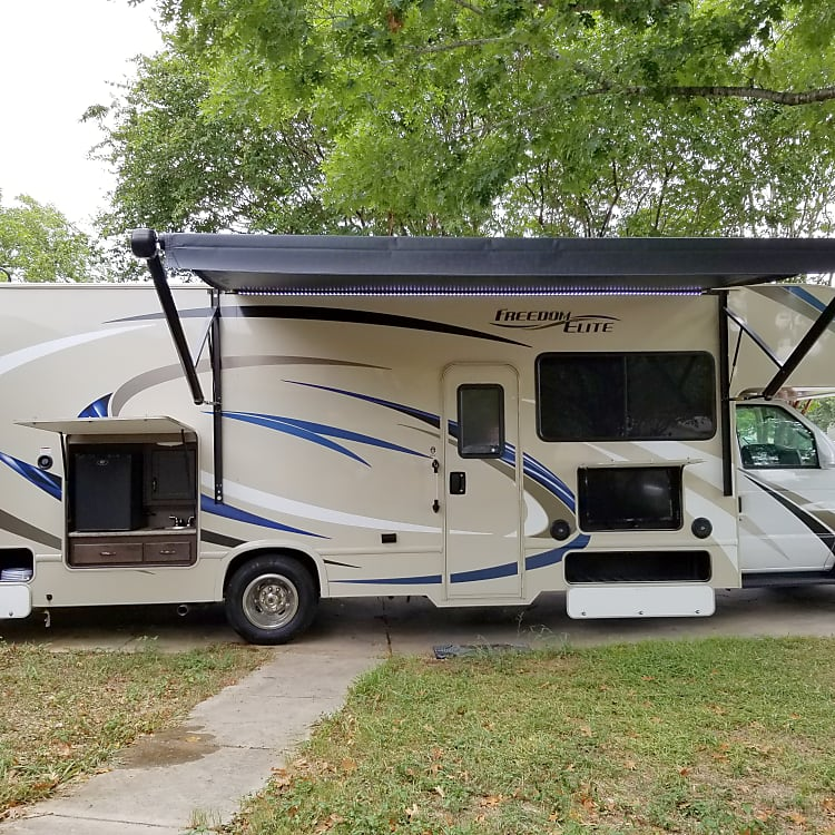 Features an adjustable awning, outside entertainment and an outside kitchen complete with a mini fridge and propane quick connection for outdoor cooking.