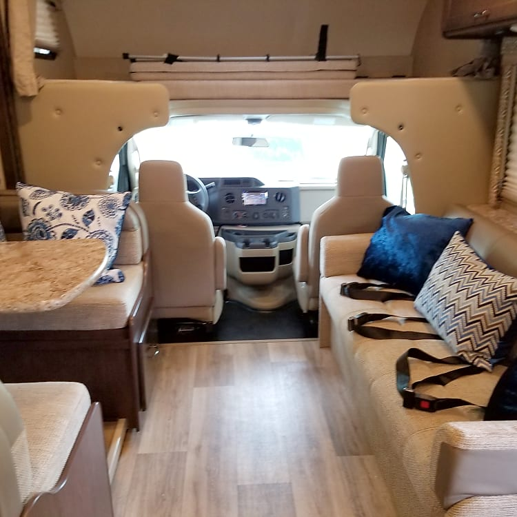 The Anywheremobile has a spacious interior.   Featured is the dinette that can seat 4 comfortably, a 3 seater couch, and a 500 lbs capacity overcab.  The dinette and couch convert into sleeping  areas and the over cab can be used as a sleeping area or for storage.