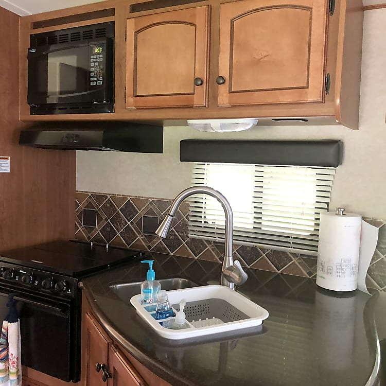 Kitchen sink, counter and stove.