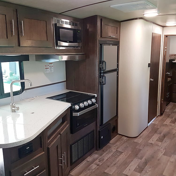 Spacious Kitchen with Bathroom door on left & private bunk room at back