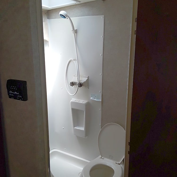 Full bathroom, includes shower, toilet, sink and mirrored medicine cabinet.
