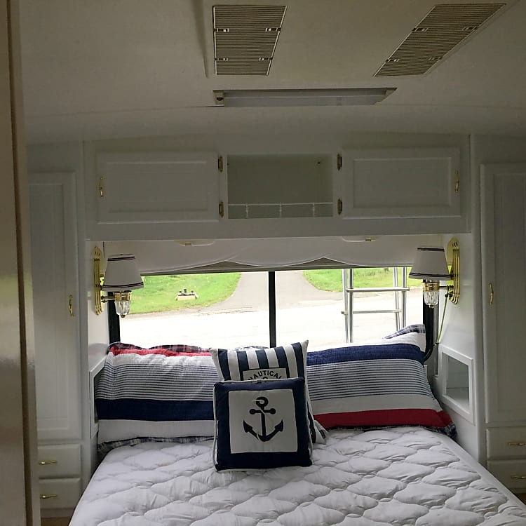 Very comfortable queen bed at rear of vehicle.