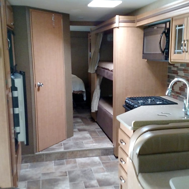 Interior-sink, stove, microwave, bunk beds.