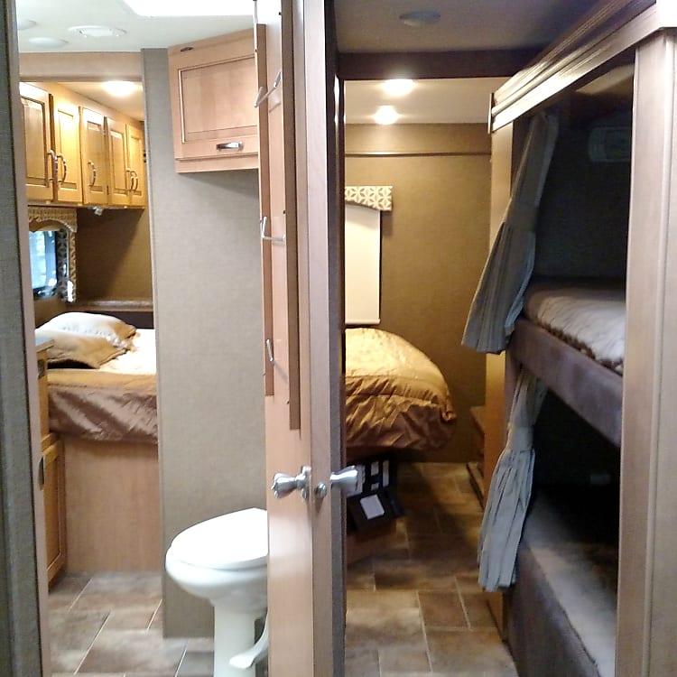 Interior-main bedroom, bathroom, bunk beds.