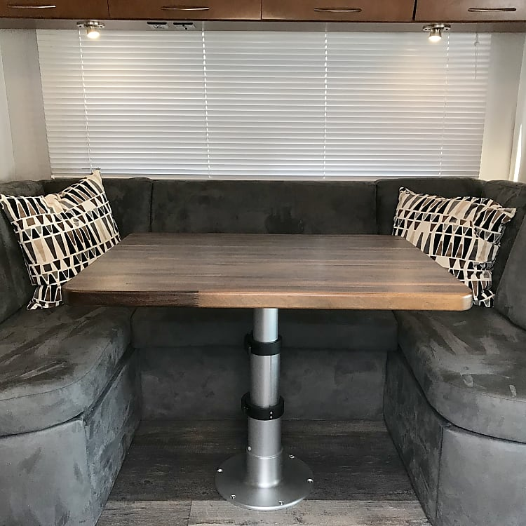 New dinette with solid walnut table, telescoping pedestal, Pendelton pillows.