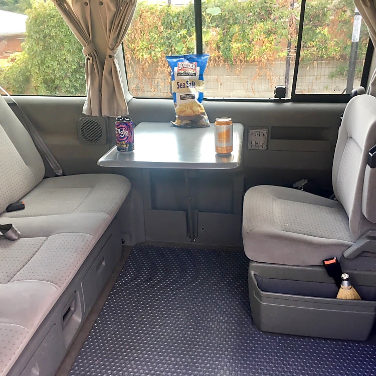 Pop up table and two sliding windows and screens.