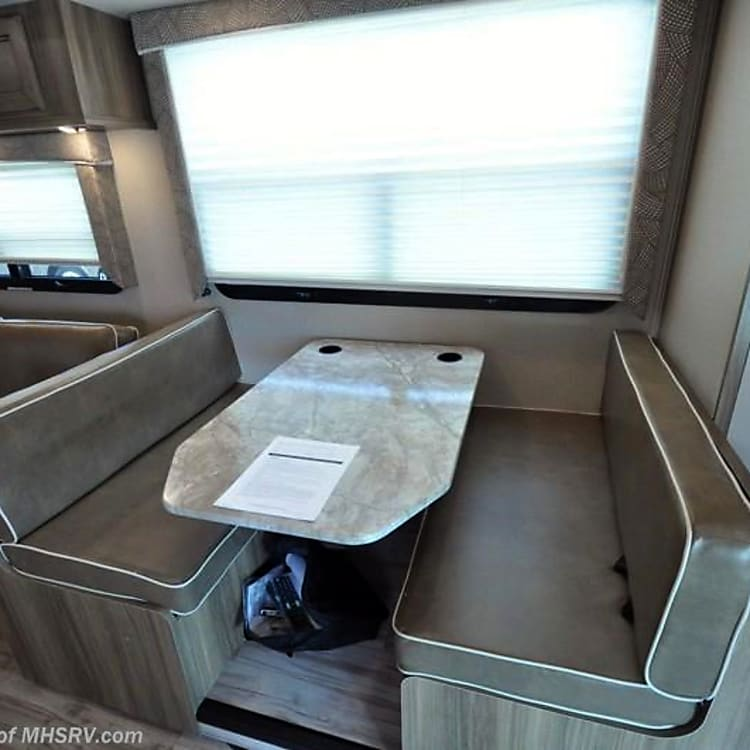 Kitchen table, folds into a bed. Also includes seatbelts that work for a car seat