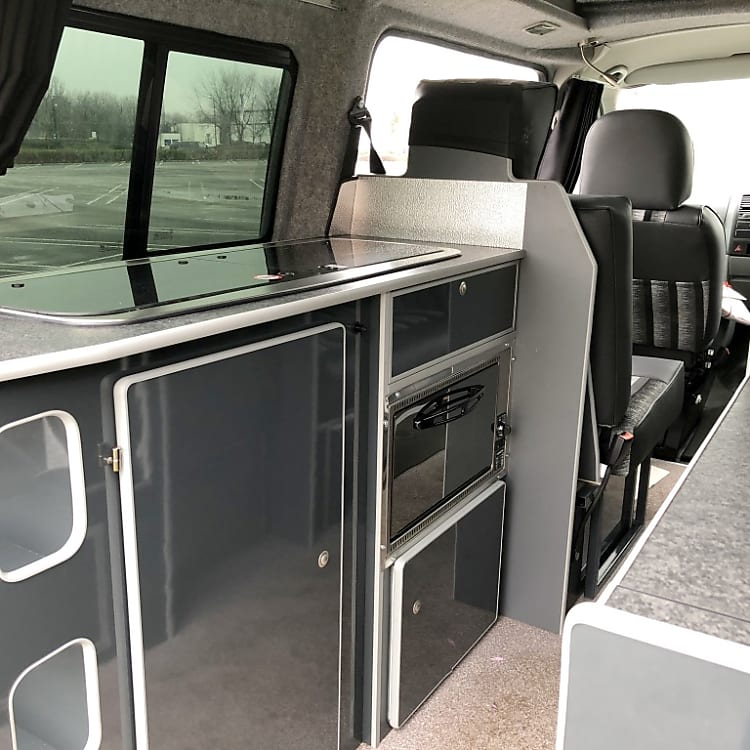The layout allows you access to the kitchen area even when the bed is made up at the front. Ideal when you want a brew first thing in the morning.