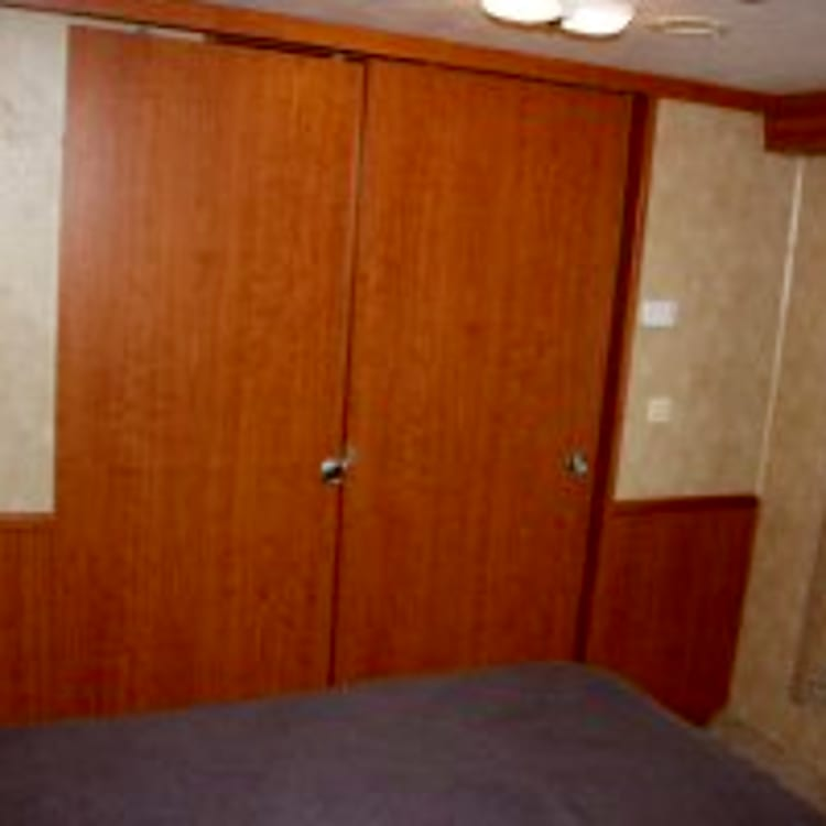 Sliding doors to bedroom can be shut to allow for privacy