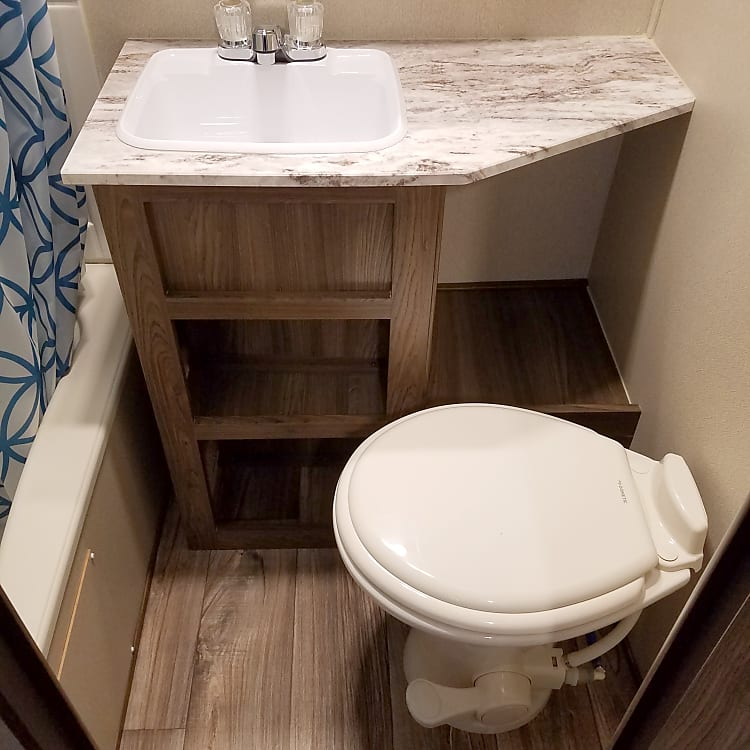 Full bathroom with sink.  Only model of this size with a bathroom sink