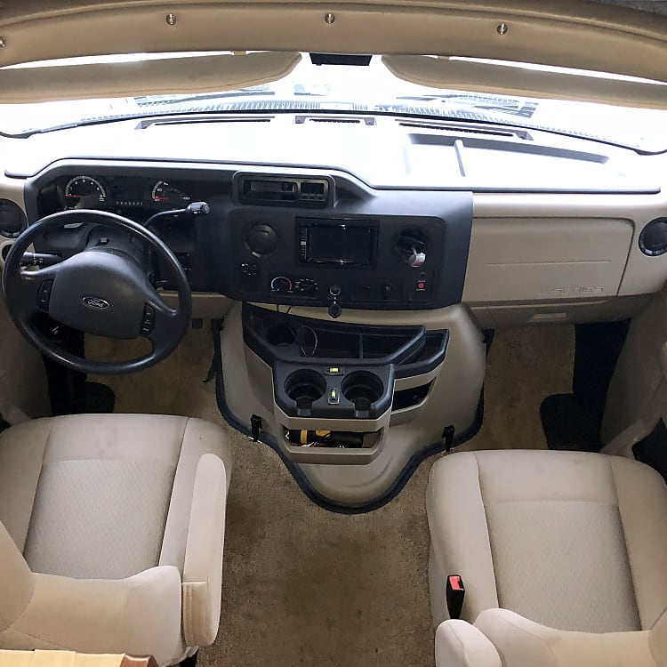 2 Captains Chairs, Navigation, Back Up Camera, Stero/ CD player and Automatic Leveling System Located in the Cab