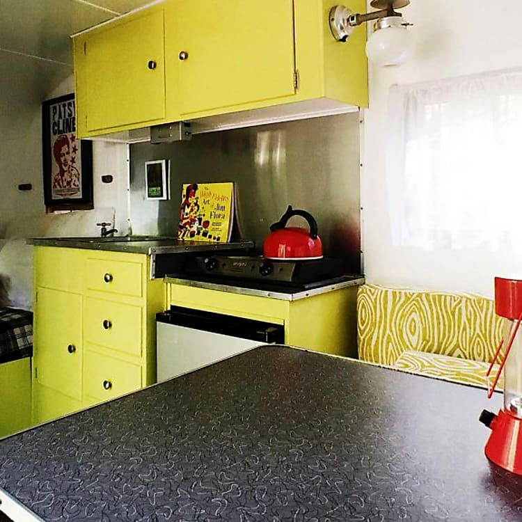 Kitchen and double bed from dinette.