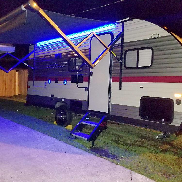 Blue LED lights, waterproof speakers, exterior TV mount and hook up.