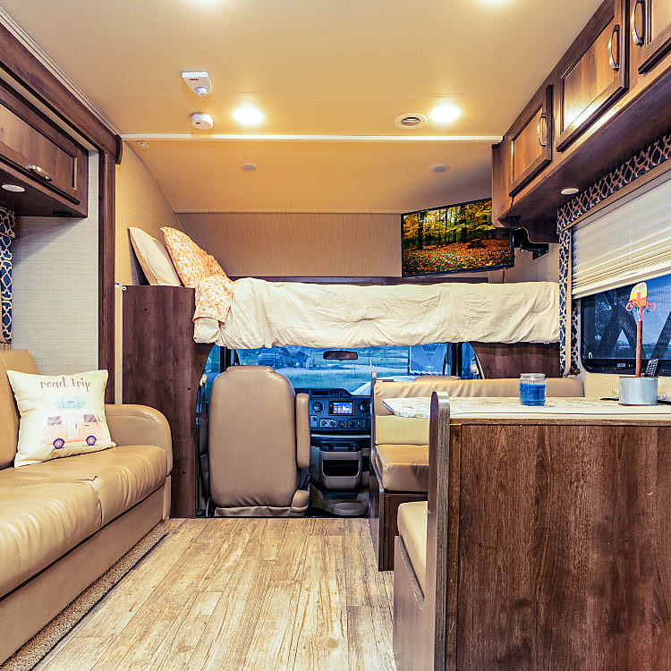 Living room/ Dinning Room and the queen size bunk over cab. TV adjusts in and out of bunk with ta  press of a button.