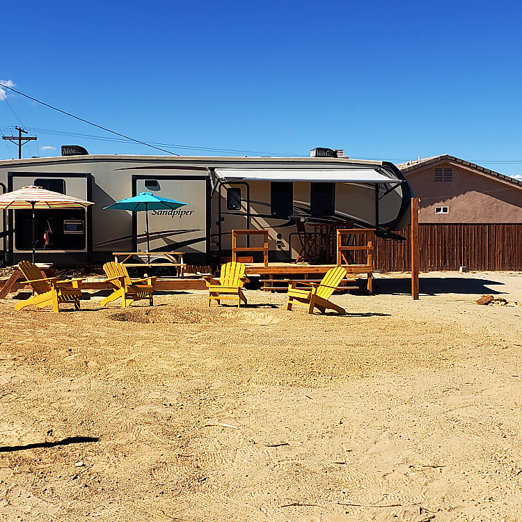 This is the Permanent Desert Location, with Salton Sea to the East and Ocotillo Wells to the West.  This area features some of the best off-road riding in all of Southern California.  The site includes a fire pit, 8'x20' Deck, 8'x12' Deck, Seating for 14 - 18 people.  The unit is hard plumbed to sewer and water and plugged in!  No noisy generator!  No full tanks!  No water shortage!  You may also have your friends join you with their own RVs for an additional small fee (dry camping only).  And, if you need more toys, an ATV rental company is located less than 1 mile from the property!  Additional photos of the permanent location are featured at the end of this post.