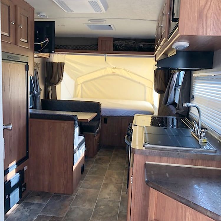 Walk in view, see kitchen, dinette, couch and front bed. Bathroom and rear bed is behind you.