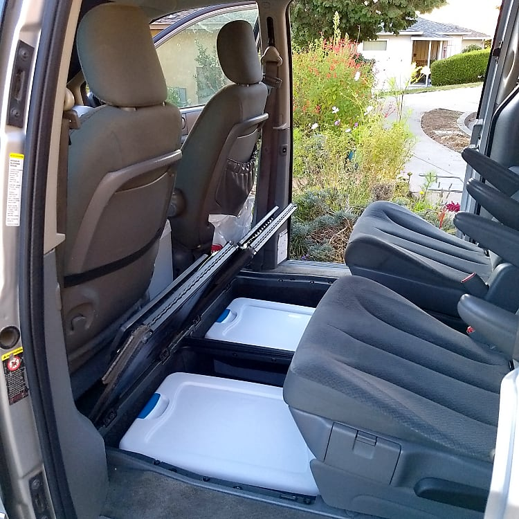 Middle seats ready, with storage boxes showing in the compartments the seats alternatively fit in.