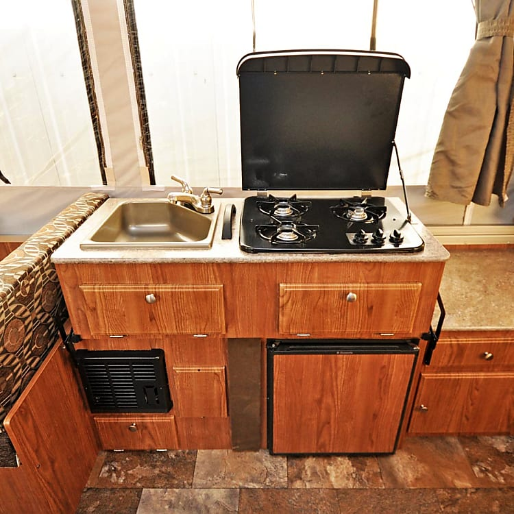 Great Full Galley Kitchen with Gas Stove, Sink and Refrigerator. Plenty of Storage.