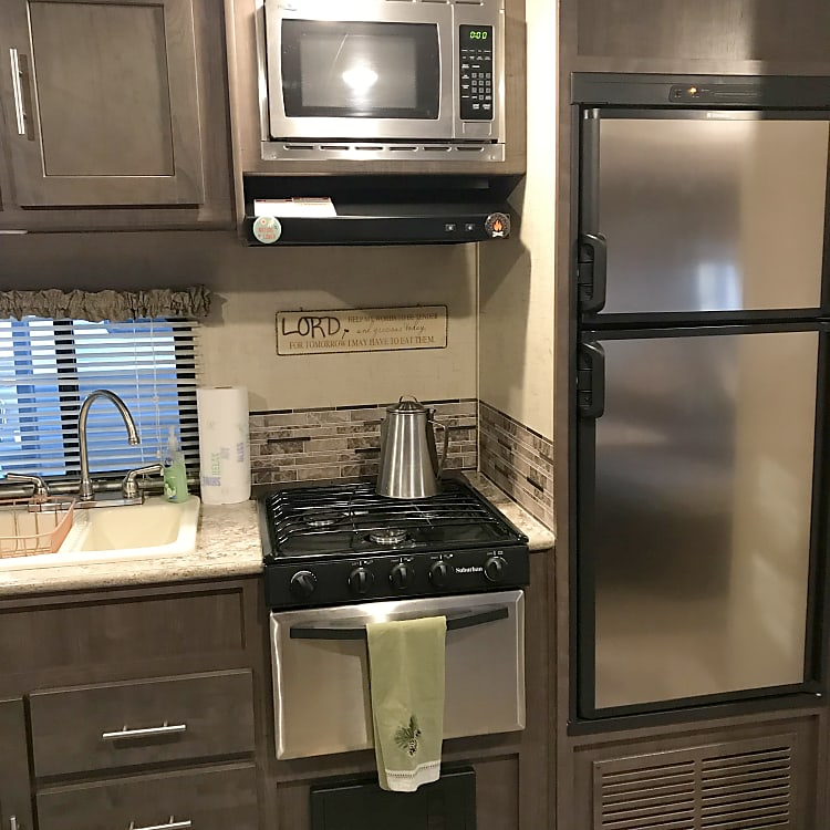 Kitchen area including a gas stove/oven, electric microwave, gas or electric refrigerator and a Keurig for easy, early morning coffee.