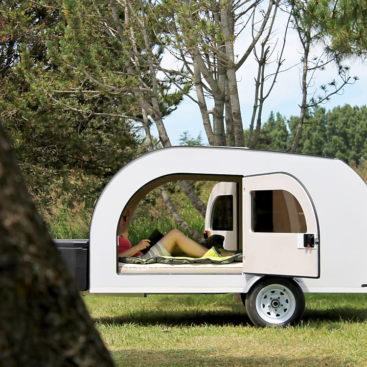 Spacious, bright interior. Queen size mattress and full kitchen access from the trunk. Check specs on droplet-trailer.com
