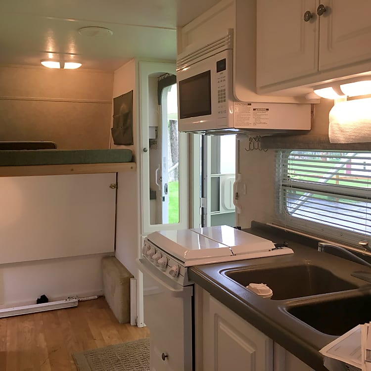Interior view showing kitchen, bunk beds and main door.