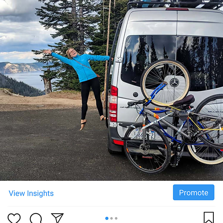 The wife showing off the bike rack in front of Crater Lake.  (bike rack can be rented as well, holds 4 bikes).